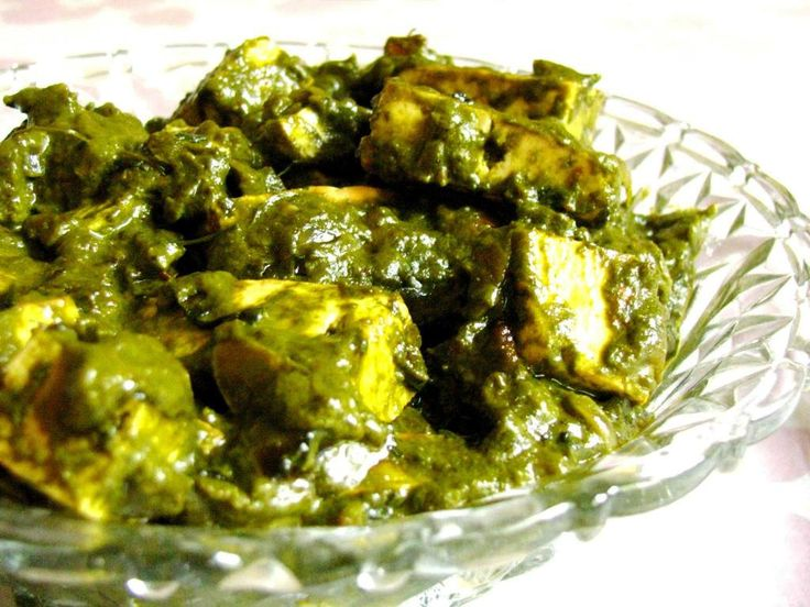 Palak paneer or Sagh paneer. Indian and pakistani spicy spinach dish with home made cheese cubes.