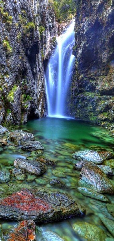 Beautiful Routeburn Falls behind the hut along the Routeburn Track Great Walk - Mt Aspiring National Park, New Zealand