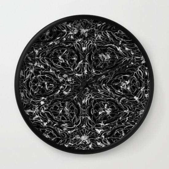 Black and white astral paint patterned wall clock