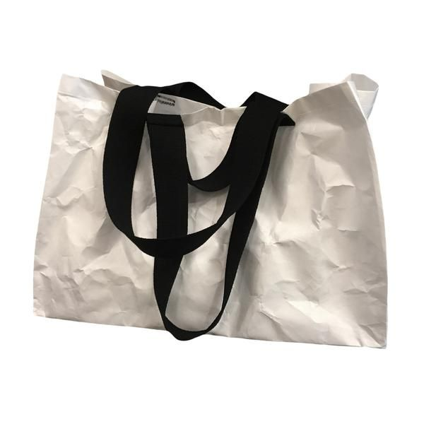 """15"""" height x 21"""" width x 14"""" depth with hand and shoulder straps in black cotton webbing. similar proportions to Ikea's iconic big blue bag. made from tyvek®, a recyclable non-woven synthetic flashspu"""