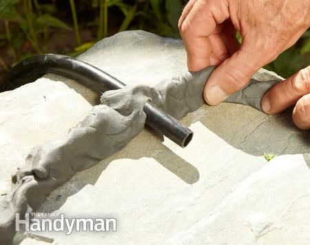 Rerouting water with putty dams between stones