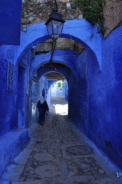 walkway surrounded by blue walls in Chefchaoun ,Morocco.I have been here, it's beautiful.