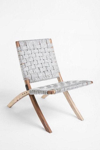 Modern, eco-friendly chair, constructed with woven twine, made of recycled silver mylar, over an eco-friendly sheesham wood frame. Indoor our outdoor use, folds down for easy storage. Used briefly ...
