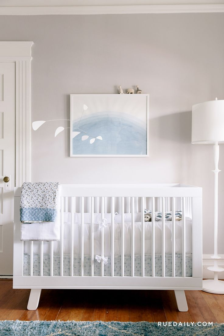 Calming nursery with white and blue colors