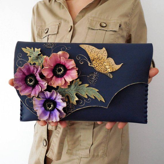 This bohemian leather floral clutch with anemone flowers is the best bag you can…