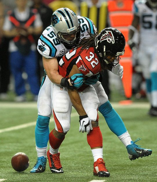 Carolina Panthers linebacker Luke Kuechly (59) pressures Atlanta Falcons running back Jacquizz Rodgers (32) during third quarter action. The Panthers defeated the Falcons 34-3 on Sunday, December 28, 2014 at the Georgia Dome in Atlanta, GA.