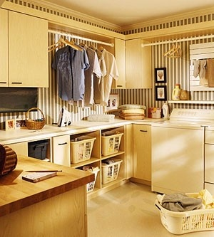 #Laundry #Organization #Inspiration Hanging racks for clothes right out of the dryer, basket storage, counter space for folding, and cabinets for supplies. All of the essentials, plus great decor.