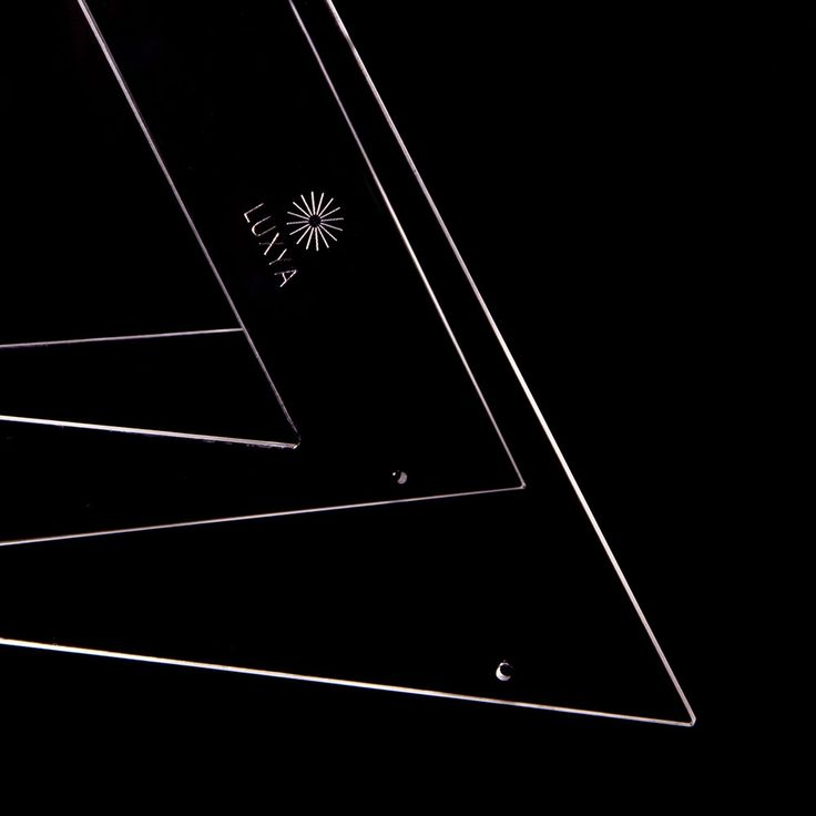 LUXYA Luxya is a ceiling lamp whose shape can be modified as you like. It has been designed to have different forms and be adaptable to different environments. Luxya is inspired by the technical drawing tools and reinvents the classical set square as a variable modular element.