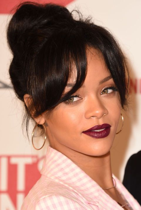 Bun With Wispy Bangs – Singer Rihanna made a surprisingly subtle red carpet appearance with a high bun and soft parted bangs. But just because she rocked a sweet hairstyle doesn't mean she didn't go bold her with makeup. We expect nothing less from the beauty chameleon. Click through to see the entire gallery and for more bun hairstyles.