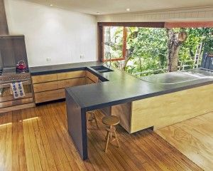 Jumna Street POPconcrete Benchtop with integrated windor tracking set into the concrete bench! This benchtop stretches the length of the owners kitchen and sprawls to the outdoors.
