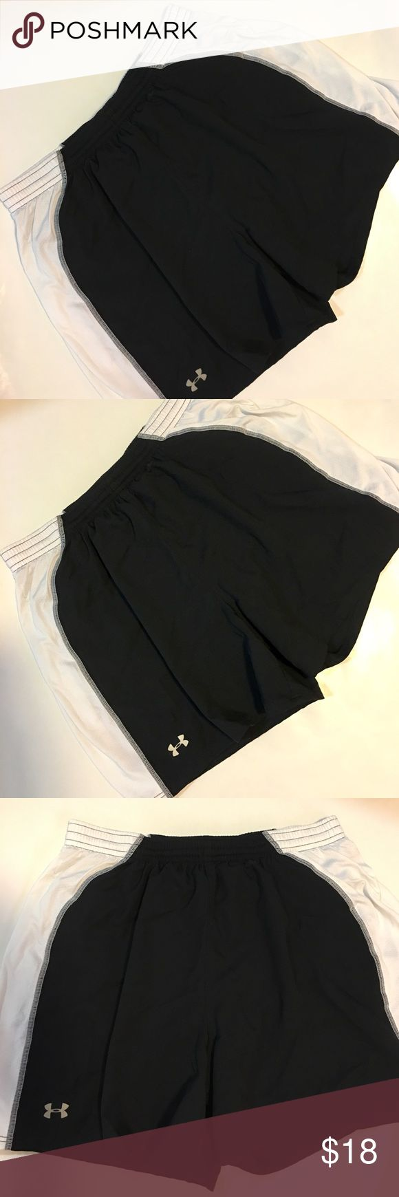 Under Armor- Ladies Black/White Workout Shorts Under Armor brand ladies black-and-white workout shorts, size SM. In great preowned condition. Please be sure to check out all of my other boutique items to bundle and save. Same day or next business day shipping is guaranteed. Reasonable offers will be considered! Under Armour Shorts