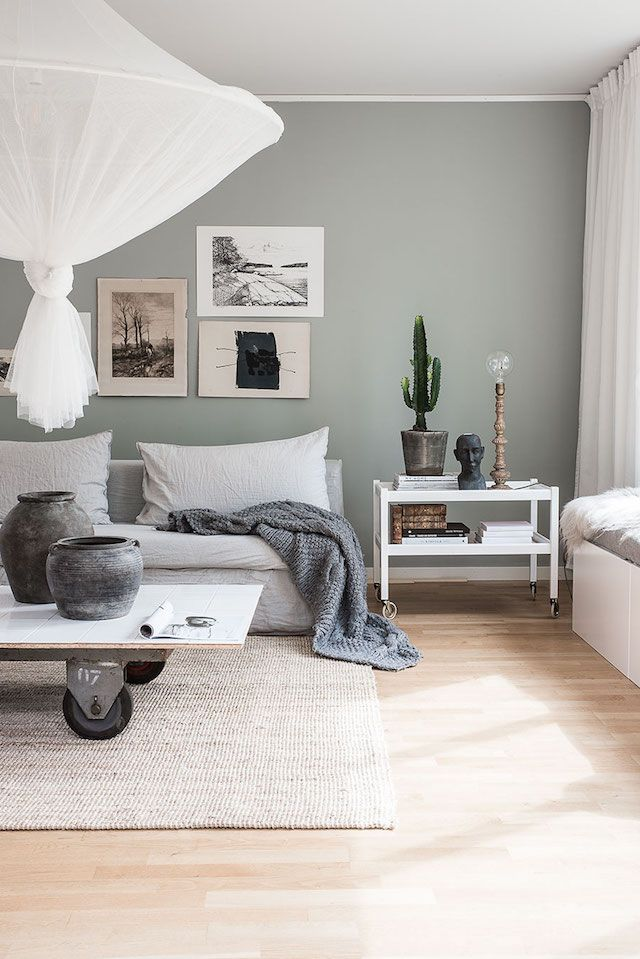 Sitting room with linens in the beautiful Stockholm home of Helena Nord - En Form av Nord / Blogger at Elle Decoration.