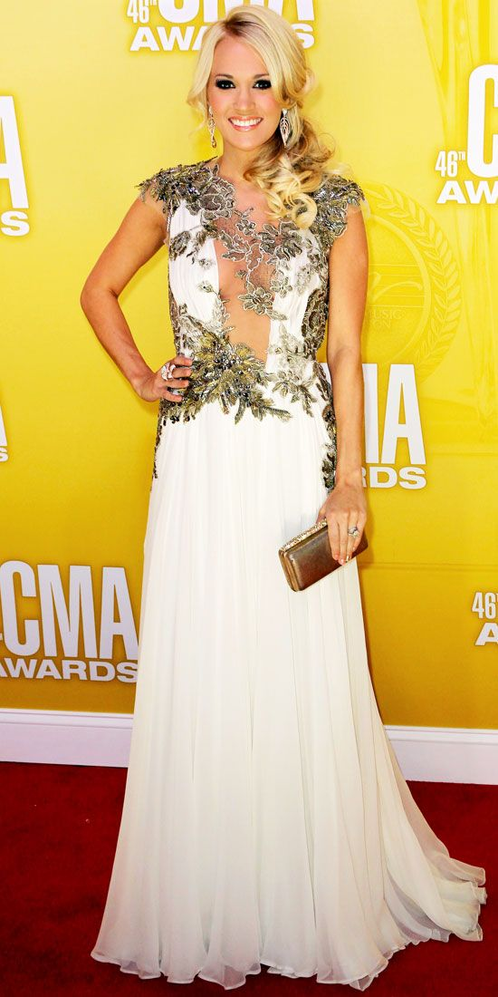 CMA Awards 2012: Carrie Underwood hosted the CMA Awards in an ivory chiffon Reem Acra dress, floral jewelry and a leather Daniel Swarovski clutch.