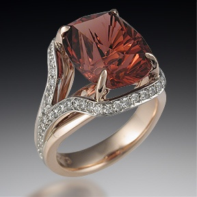 This two-tone, platinum & rose gold cocktail ring features a row of pave suspended around the stone setting.  Depicted in the main style image is a Larry Woods Four Directions cut tourmaline.  Priced for a single metal.  Please inquire for two tone pricing.