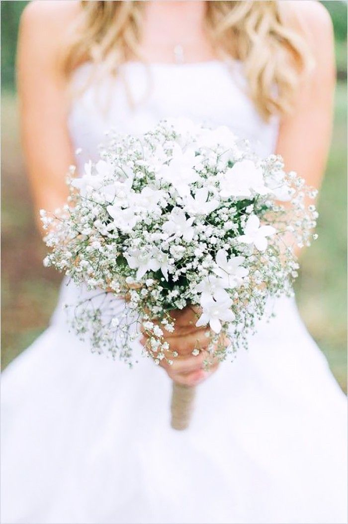The classic all-white bouquet never goes out of style. A bushel of delicate white baby's breath and charming stephanotis is an affordable yet pretty bouquet. According to the traditional language of flowers, stephanotis symbolizes marital happiness in the early 1900s.  12 Stunning Wedding Bouquets That Went Viral on Pinterest via @MyDomaine