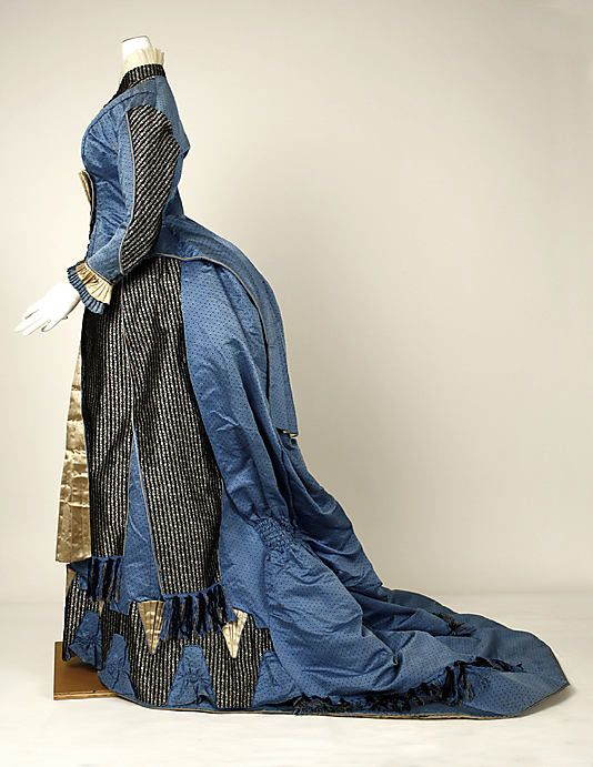 Dress      1880 - I'm still amazed that women were able to sit down in these!