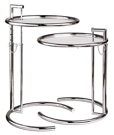 """Eileen Gray side table.    Designed in 1927 as a bedside table for the guest room in E-1027, the home she designed for herself (and Jean Badovici) in Cap Martin, France, the asymmetry of this piece is characteristic of her """"non-conformist"""" design style in her architectural projects and furniture. Notably, this piece also has specific utility, as it can be adjusted such that one can eat breakfast in bed on it. Gray's sister had requested such accommodation during her visits to E-1027."""