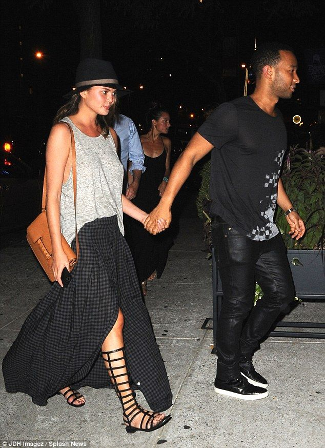 John Legend and his wife Chrissy Teigen walked hand in hand to dinner at Bar Pitti in SoHo on July 10, 2014 http://dailym.ai/1oqW8RR
