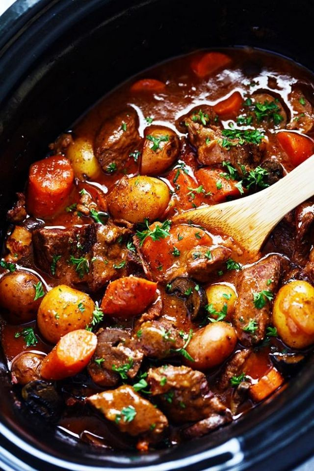 Slow Cooker Beef Bourguignon has crazy tender melt in your mouth beef and hearty veggies slow cooked to perfection in a rich sauce. This meal is comforting and perfect for the cold months ahead! This