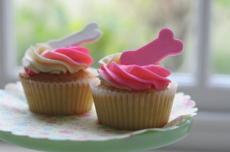 Perfect puppy party pink and white cup cakes.