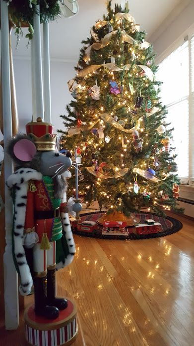 I am sharing my traditional Christmas tree and rotating tree stand that I inherited from my Grandma but you can see my whole house tour here.
