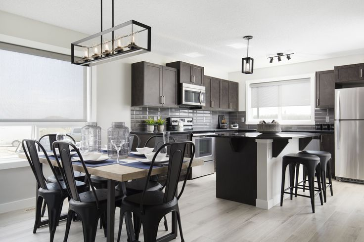 Kitchen and dining nook in Creations by Shane Homes Arbor Duplex Showhome in Legacy in southeast Calgary #nook #diningnook #diningroom #kitchen