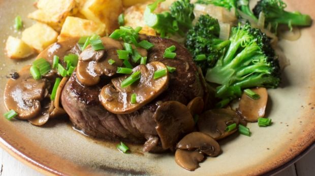 Beef eye fillet with mushroom jus, roast potato cubes and broccoli.