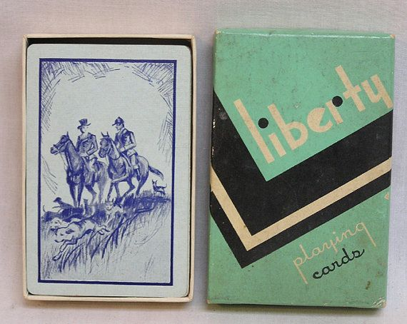 Nice 1930s Liberty Playing Cards deck with unusual Ace and dancing joker. Image on back is a man and woman at fox hunt. Minimal wear. Original box.