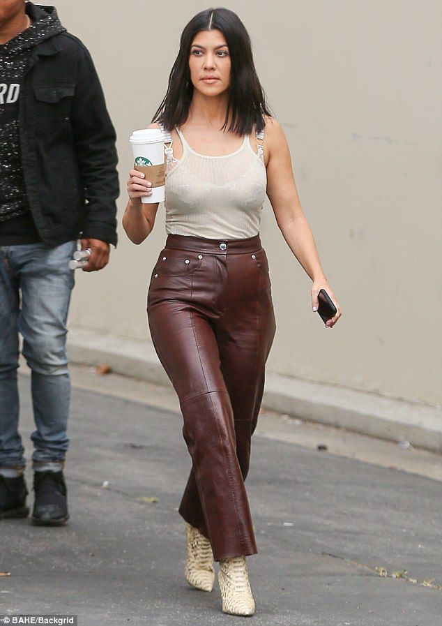 968415d42fb4d Kourtney Kardashian flaunts figure in leather pants and sheer top ...
