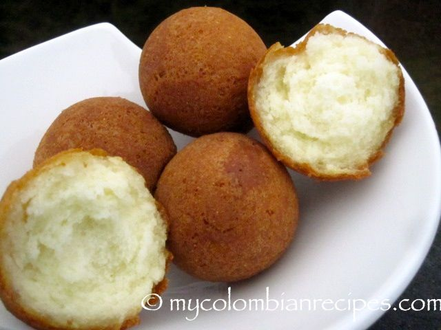 Buñuelos Colombianos     Vegetable oil for frying     3/4 cup cornstarch     1/4 cup yucca flour or tapioca starch     1 cup finely grated feta cheese     1/2 cup finely grated Queso fresco or fresh farmer cheese     2 eggs     1/4 teaspoon baking powder     2 tablespoons sugar     Pinch salt     1 tablespoon milk