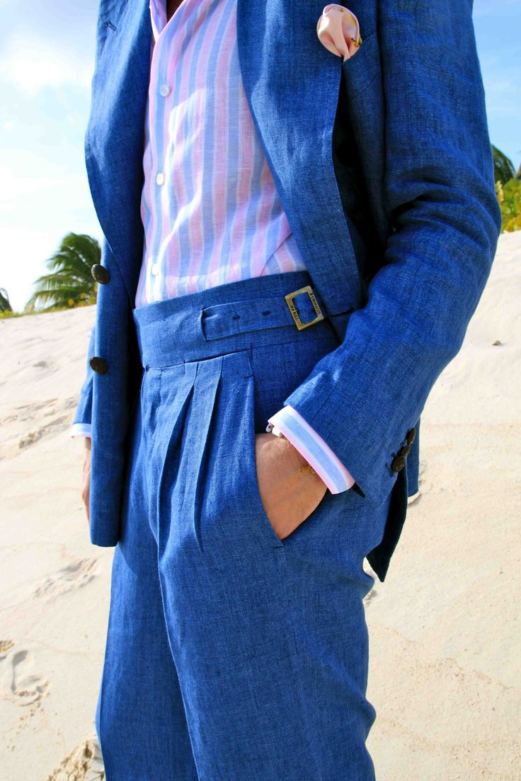 Blue linen suit with pleated trousers and side tab