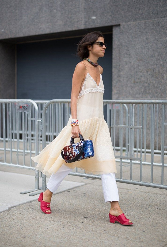 This fall, try wearing your dresses over jeans.