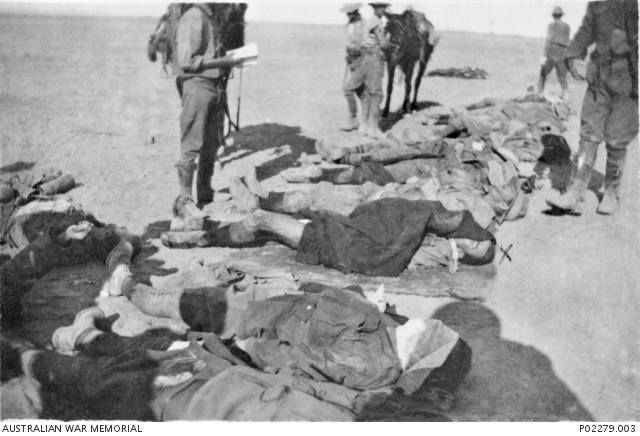 Dead Australians following the Charge of the Australian Light Horse at Beersheba, Palestine. The man marked with an 'X' is Australian test cricketer Albert Tibbie (or Tibby) Cotter. A well known sportsman, who was killed by a Turkish soldier who had already been captured.