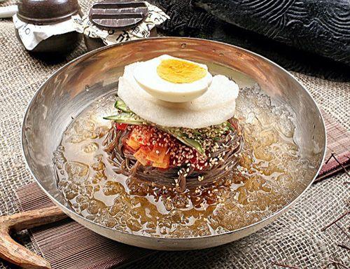 물냉면(mul-naengmyeon) / Chilled Buckwheat Noodle Soup Noodles made with buckwheat and starch. Served in a chilled beef broth with pickled radish, sliced Korean pear and a hard-boiled egg. It is often served with a side dish of vinegar and mustard.