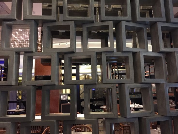 PHOTO ONE: Cement cinder blocks used as a wall for restaurant Cotta at Crown. The use of hollowed out cinder blocks let the customers enjoy the restaurant but still see what is happening out in the casino. The positioning of the blocks has no order. Creates the design element of pattern.