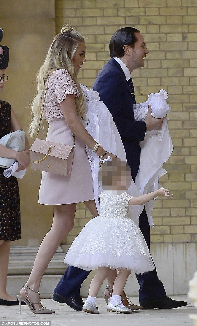 All together now: Petra and James led the way into the church alongside their two-year-old...