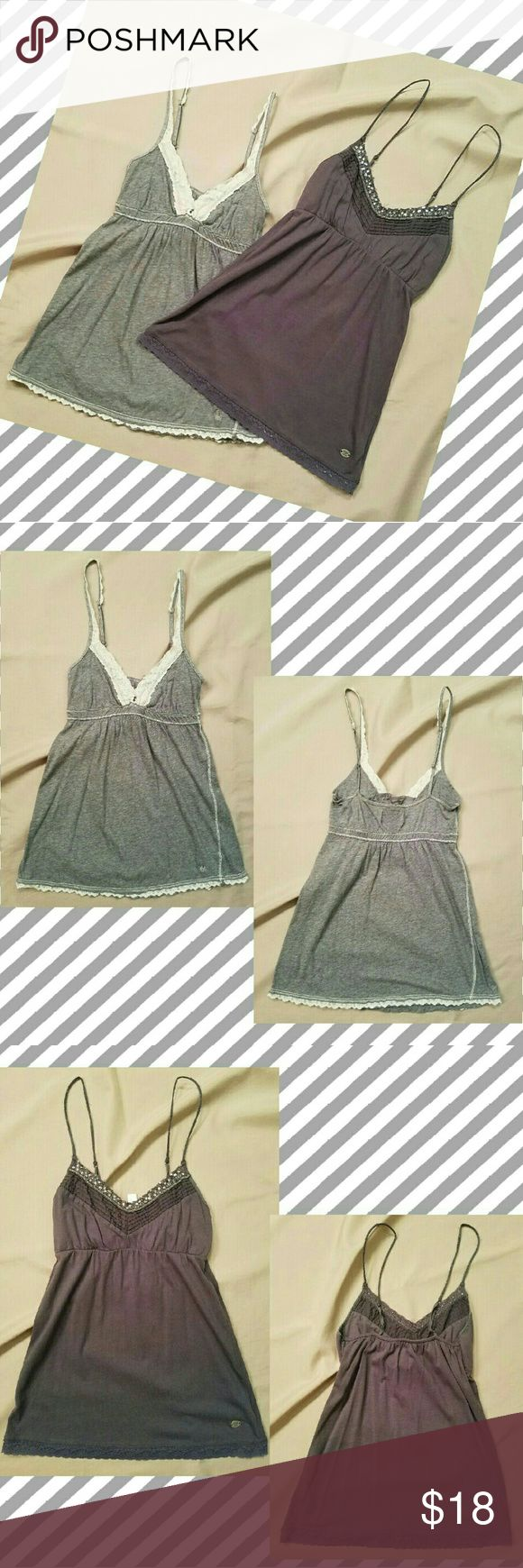 💲Drop⤵Abercrombie Fitch Tank Top/Camisole Bundle ♥Heather Grey Strappy Deep V tank with baby-doll waist. Loose fit below bust, adjustable straps. Cream colored lace lines bust, staps, & hem. Two beads adorn center.  Size: Small 100 % Cotton   ♥Dark Grey Strappy Deep V tank with baby-doll waist. Loose fit below bust,  adjustable straps. Pleated styling at top. Dark grey lace lines bust & hem, sequins & beading also attached to the top lace lining. Size: Medium Body: 55% Cotton, 45% Modal (a…