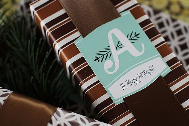 Free Printable Monogram Christmas Gift Tags- I'm not a fan of the tag, but love the idea. I must remember this!
