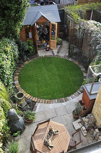 a circular lawn with a brick border small garden idea