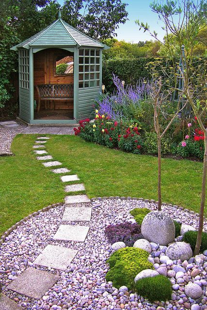 Pic: Neat small garden design with seat in gazebo, lawn, border and peps led areas. From the small gardens board