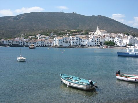 A picture of the small catalan village and bay made famous by SALVADOR DALÍ , the brilliant catalan painter .