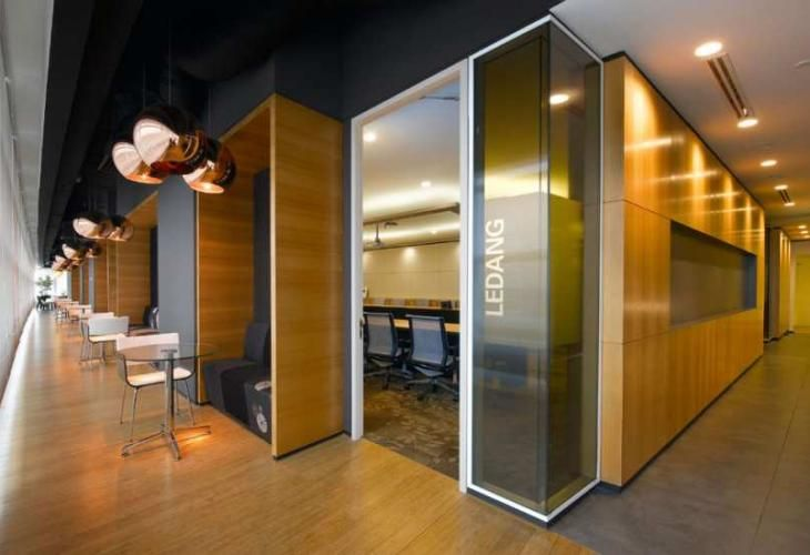"Meeting nooks along ""dark"" hallway.  Down lights at floor level bounce light up off the floor"