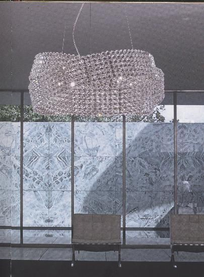EPI LUMINAIRES : Suspension Diamante dotée de trois anneaux de cristaux illuminés, dotés de LED Multicolore. Un produit à découvrir chez EPI Luminaires. Une sélection de la rédaction de source-a-id.com.