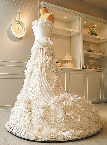 """This is a cake.  No, really.  It's a CAKE. Takes the idea of """"centerpiece cake"""" to a WHOLE new level!! And probably costs as much as a real gown...."""