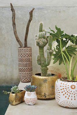 Live Give Love - Anthropologie | Inspiration for DIY Planters ~ place stickers on terracotta points, paint white, peel off stickers, admire your pretty patterned planters