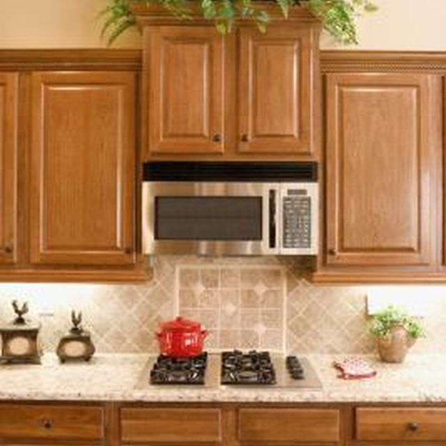 Light-colored granite can reflect more light for small kitchens.