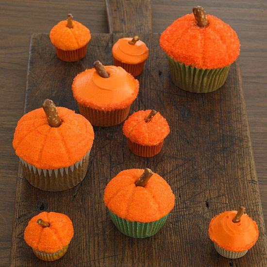How adorable are these Easy Pumpkin Cupcakes? Learn how to make them here: www.bhg.com/...