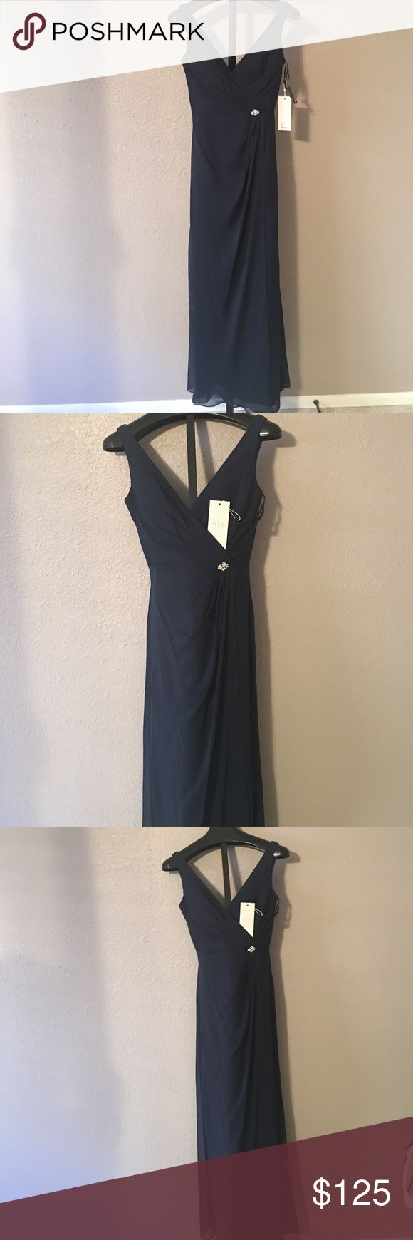 Brand new with tags. Stunning evening gown., Stunning size 6 black evening gown. Beautiful crystal brooch and pleated front.Dress designed by David Tutera. Popular with celebrities. Gather and Gown Dresses Prom