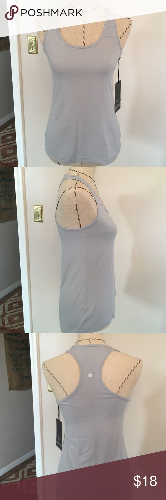 NWT 90 Degree by Reflex Workout Tank Brand new, never worn workout tank. Soft and stretchy moisture wicking technology fabric. Racerback style. It's a silver gray color. 90 degree by Reflex Tops Tank Tops
