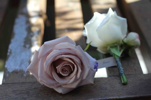 Rose buttonholes by Blooms by Bethan